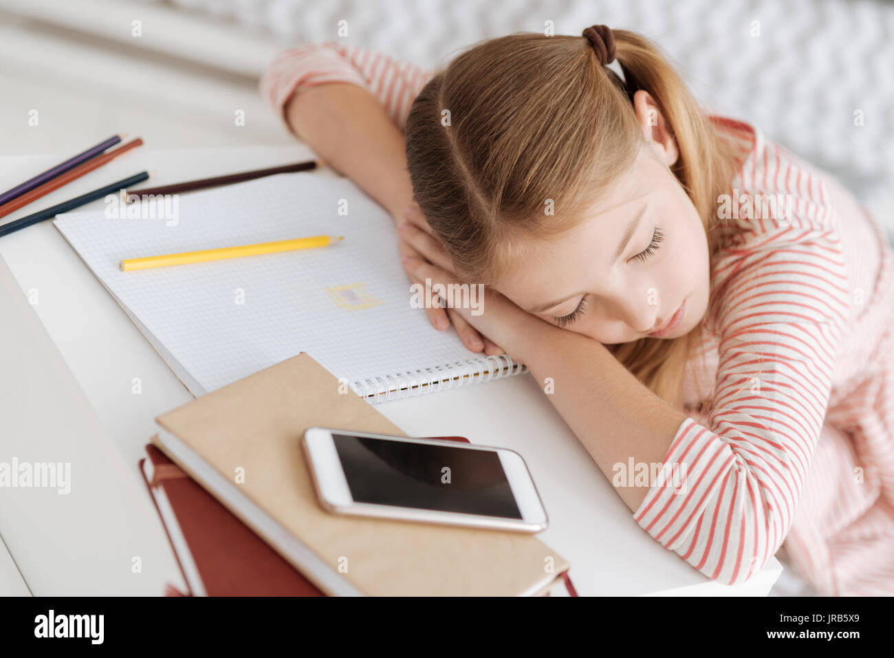 Exhausted child sleeping after drawing - Stock Image