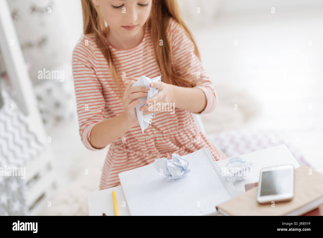 Close up of child struggling with homework - Stock Image