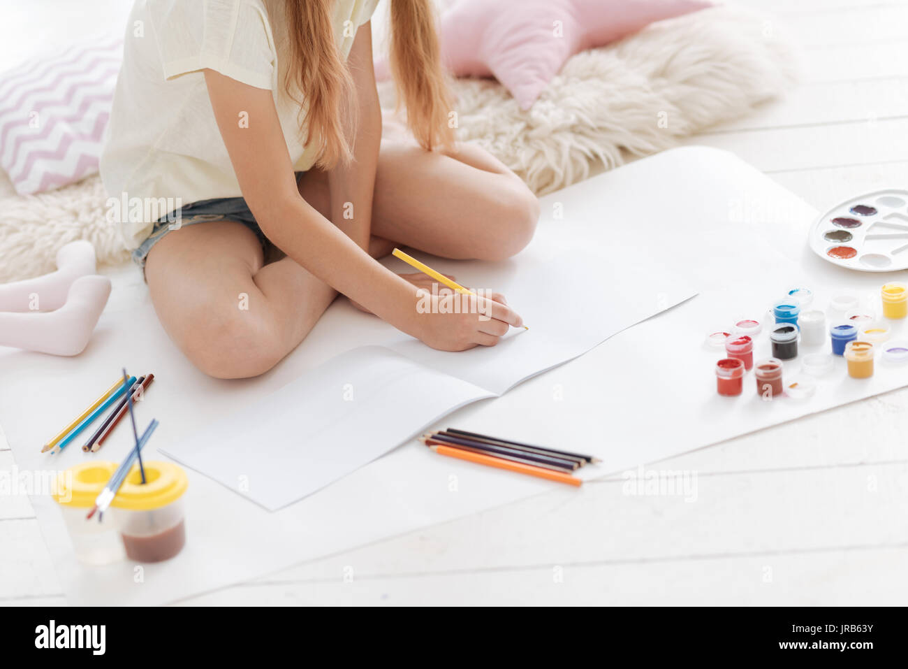 Close up of girl drawing with pencils - Stock Image