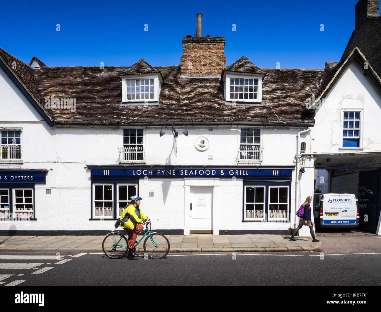Loch Fyne restaurant  - a cyclist passes the Loch Fyne restaurant in Cambridge UK. Part of an upmarket chain that specialises in fresh seafood dishes. - Stock Image