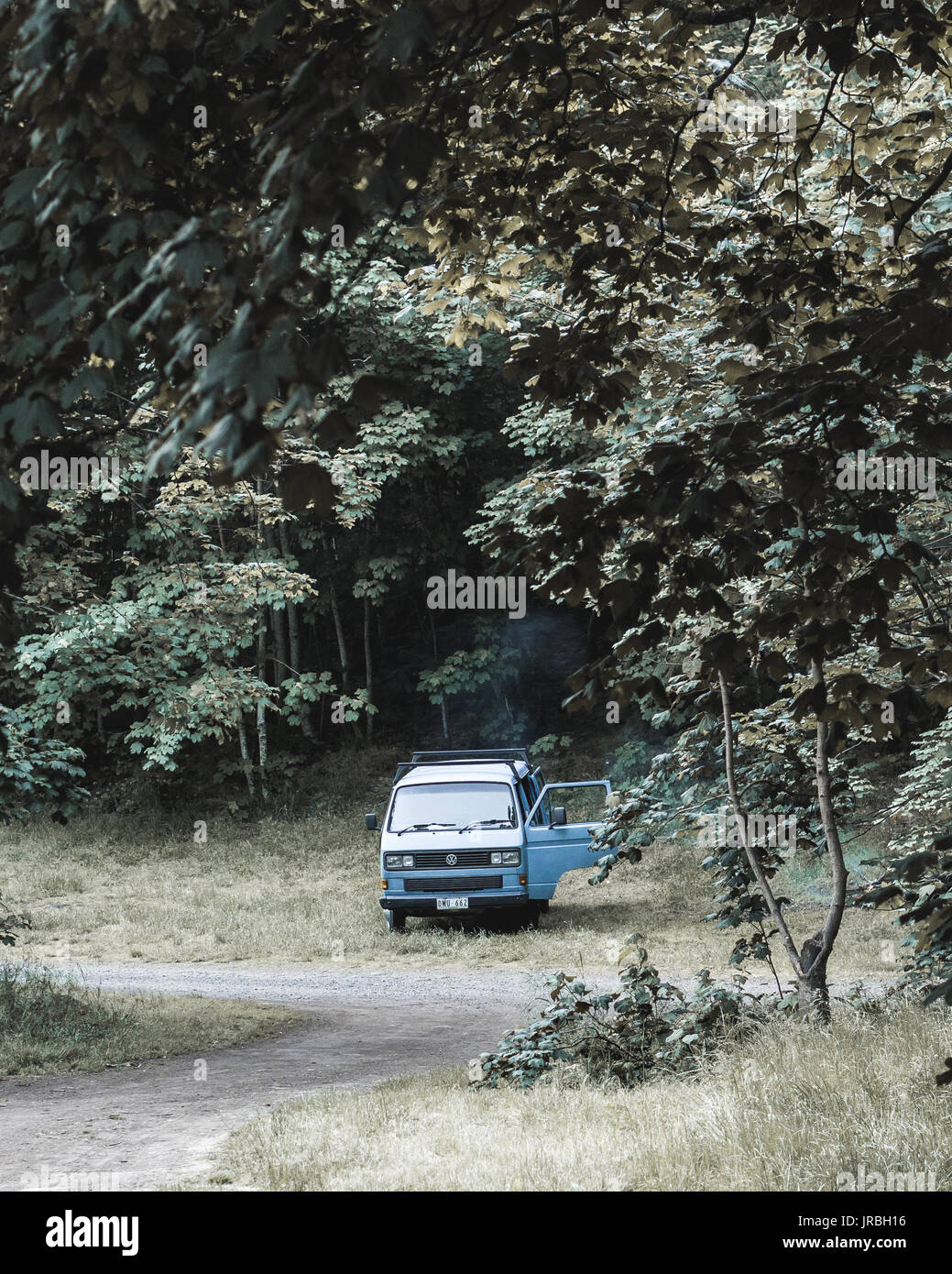 Blue hipster van parked for camping at Mt Franklin near Daylesford. Stock Photo