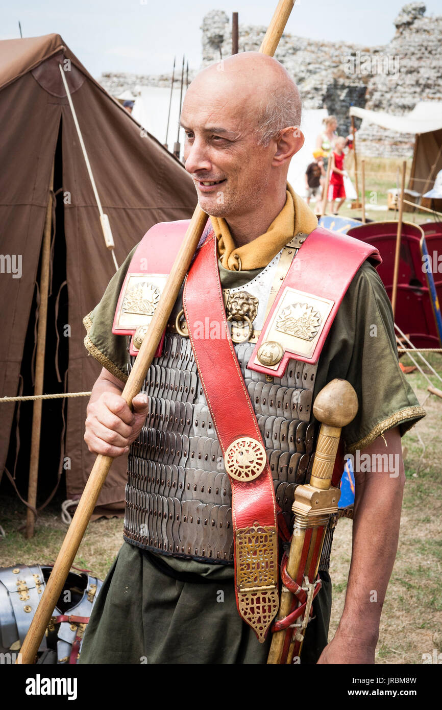 Living history re-enactor dressed in Roman legionary uniform and armour, shouldering a pilum, javelin. - Stock Image