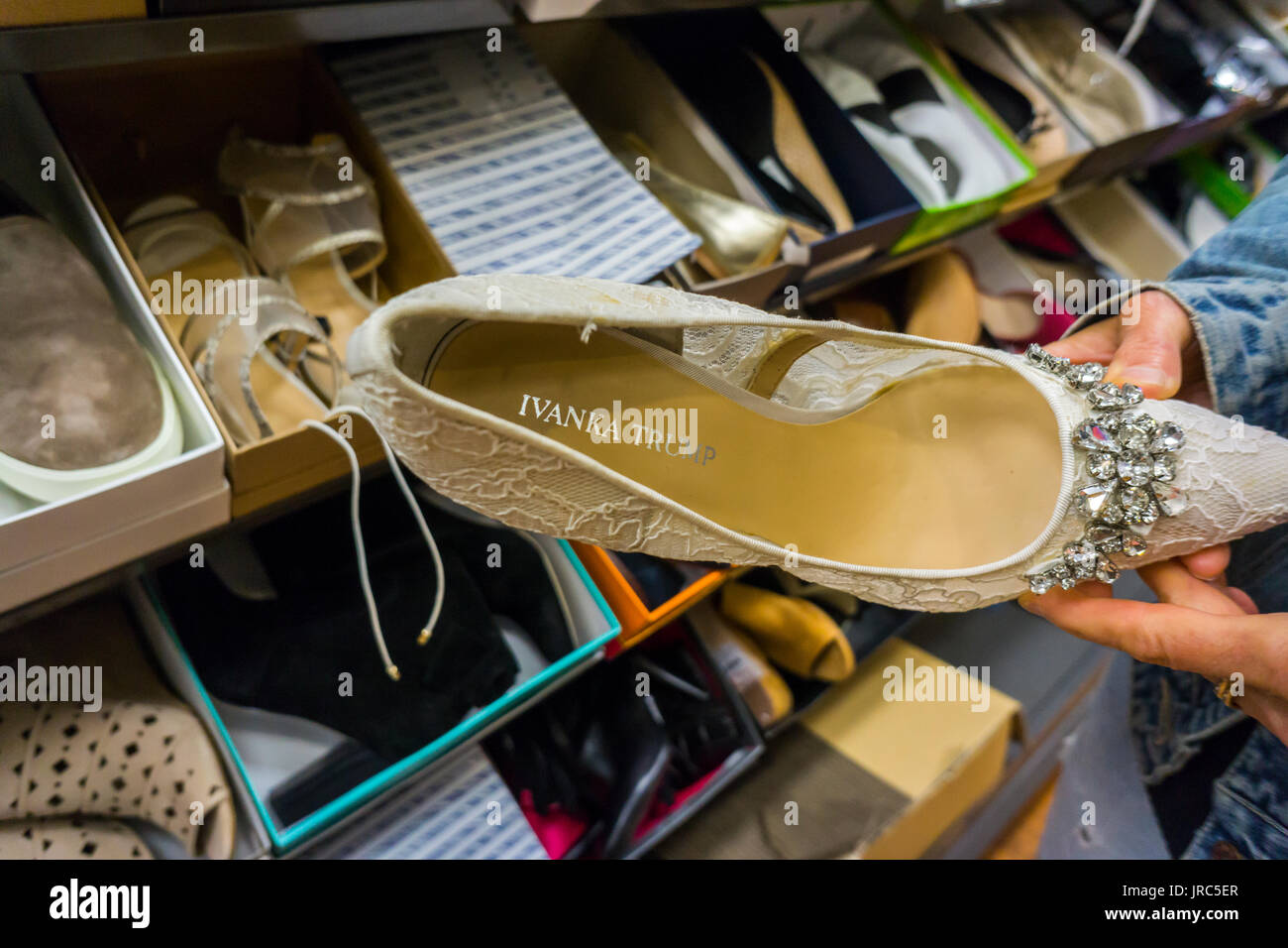 A shopper admires Ivanka Trump designer shoes being sold in an off-price retailer's clearance department in New York on Tuesday, July 25, 2017.  (© Richard B. Levine) - Stock Image