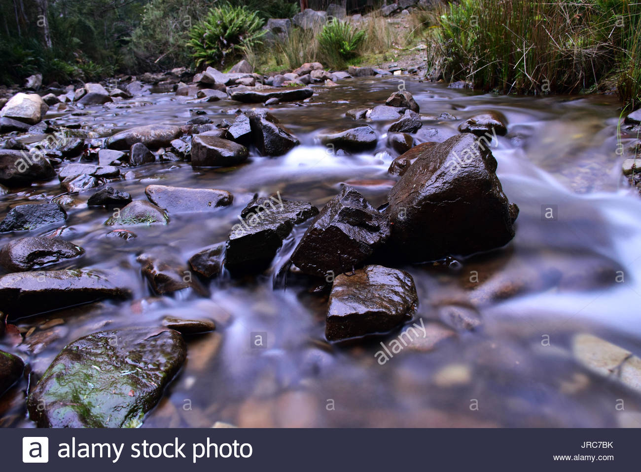 Silky Water, Solid Rocks Stock Photo