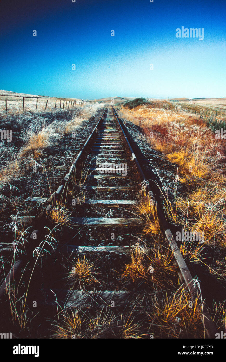Disused railway tracks in the countryside - Stock Image