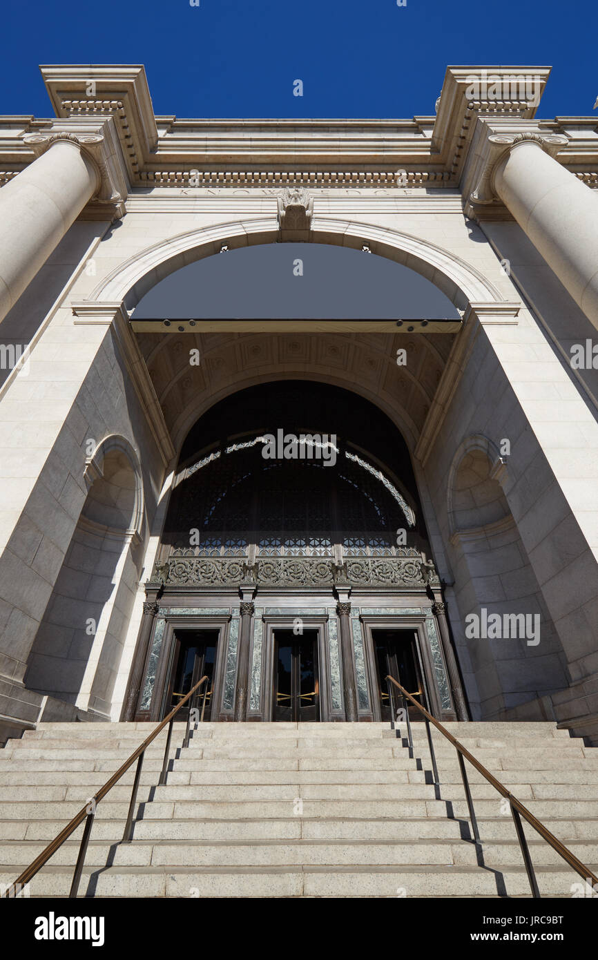 American Museum of Natural History building entrance with staircase in a sunny day, blue sky in New York - Stock Image