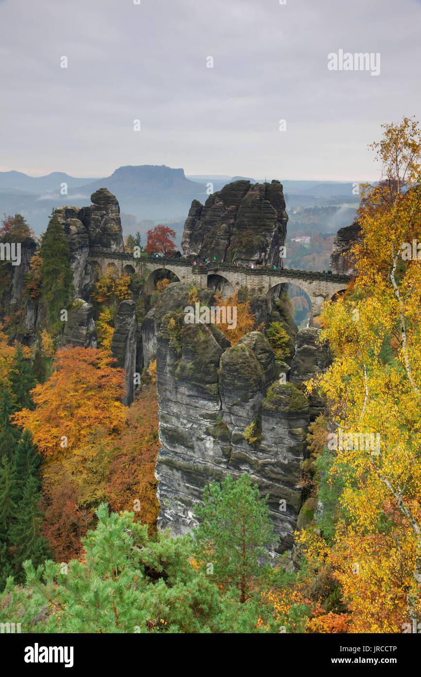 Bastei Bridge / Basteibrücke above the Elbe River in the Elbe Sandstone Mountains in autumn, Saxon Switzerland National Park, Saxony, Germany - Stock Image
