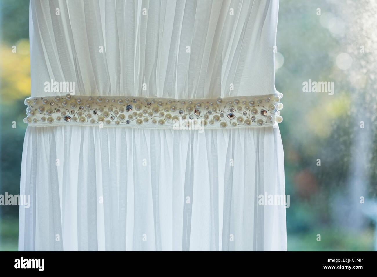 Wedding Dress Hanging Up Stock Photos & Wedding Dress Hanging Up ...