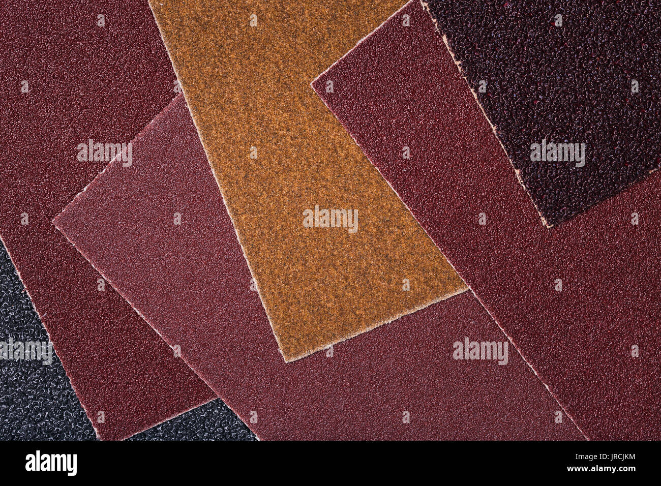 The texture of sandpaper with different grits - Stock Image