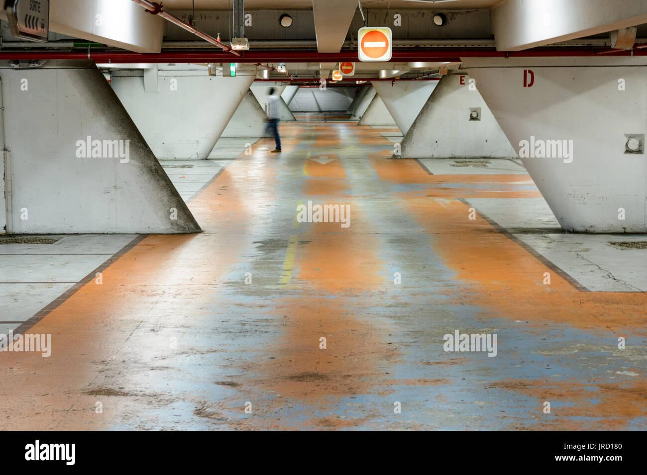 Old decrepit underground parking lot. Stock Photo