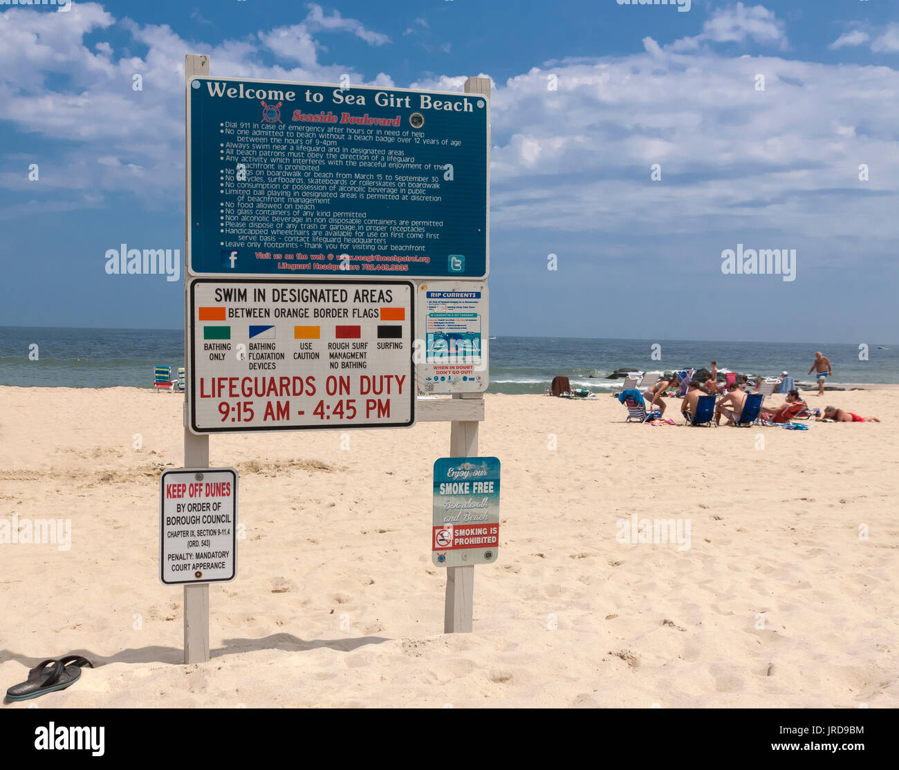 Beach sign outlining rules, regulations, & ordinances in Sea Girt, New Jersey, United States. - Stock Image