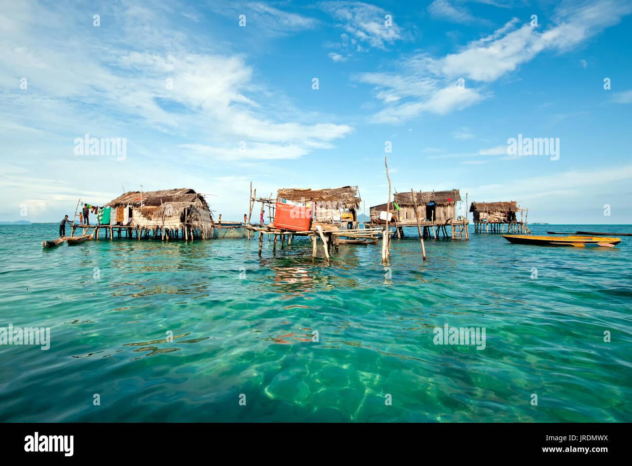 Semporna , Malaysia: September 17, 2011: Bajau Laut or sea nomadic people stilted houses at the village in Tun Sakaran Marine Park. - Stock Image