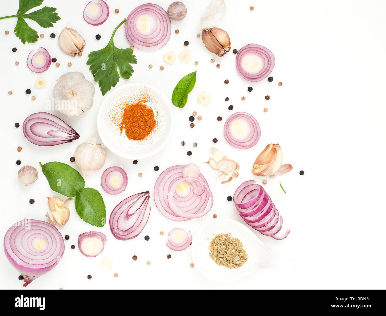garlic onion pepper colorful spices tropical flavoring food on white background Stock Photo