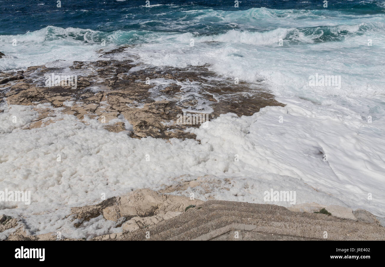 Foam produced by the high tide - Stock Image
