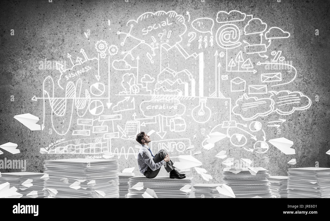 Businessman dreaming about future business. Stock Photo