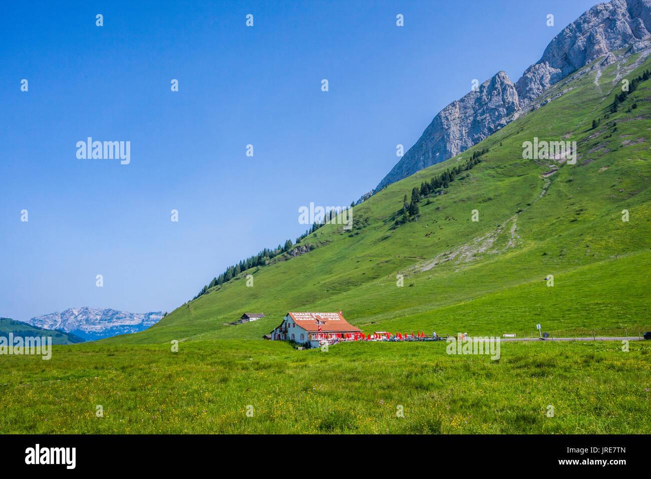 France, Haute-Savoie/Savoie, French Alps; Chalet Savoyard restaurant at the Col de Aravis mountain Pass - Stock Image