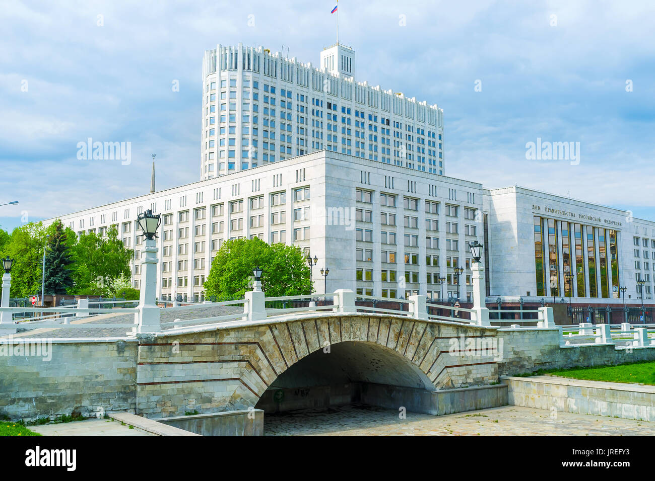 MOSCOW, RUSSIA - MAY 11, 2015: The small humpbacked bridge over non-existent riverbed Presnya, located next to the Government building, on May 11 in M - Stock Image