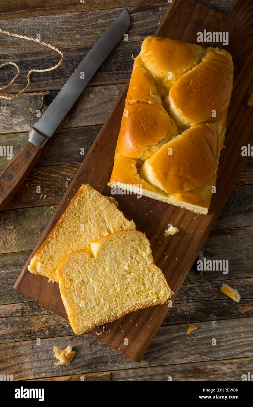 Homemade Sweet Brioche Bread Loaf Cut into Slices - Stock Image