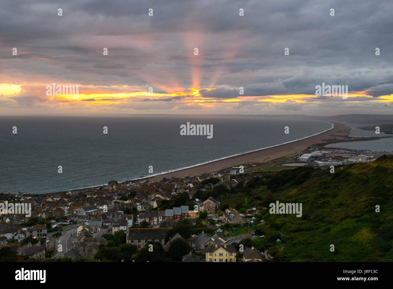 Portland, Dorset, UK.  4th August 2017.  UK Weather.  View of the sunset across Fortuneswell from The Heights on Stock Photo