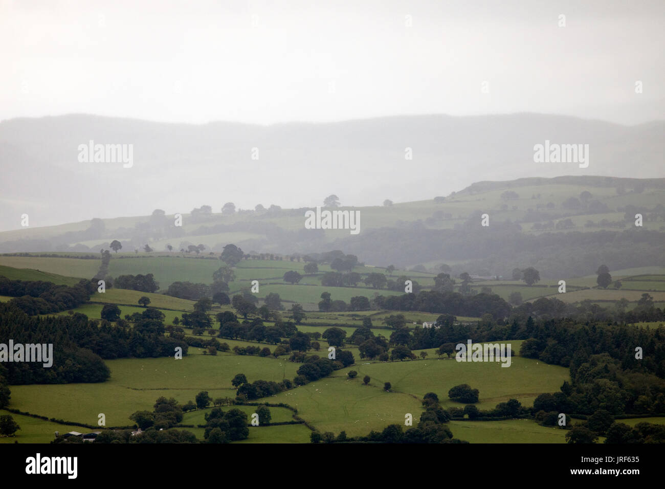 Rain falling in summer across the Vale of Clwyd and beyong in Denbighshire, Wales, UK - Stock Image
