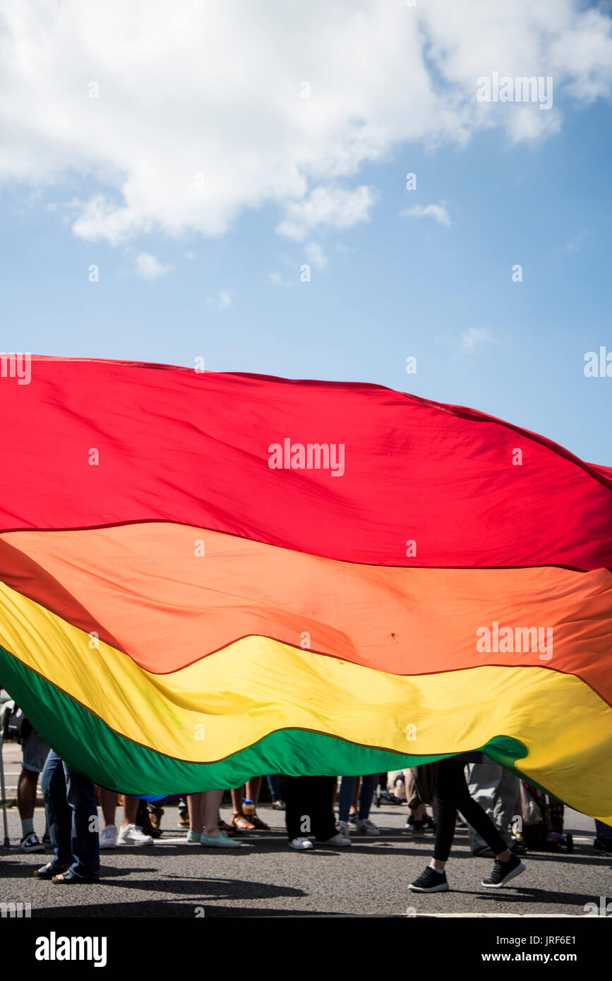 Brighton, UK. 5th August, 2017. The LGBTQ  flag was beared at Gay Pride Celebrations in Brighton, 5th August 2017. Credit: Lucy Ranson/Alamy Live News - Stock Image