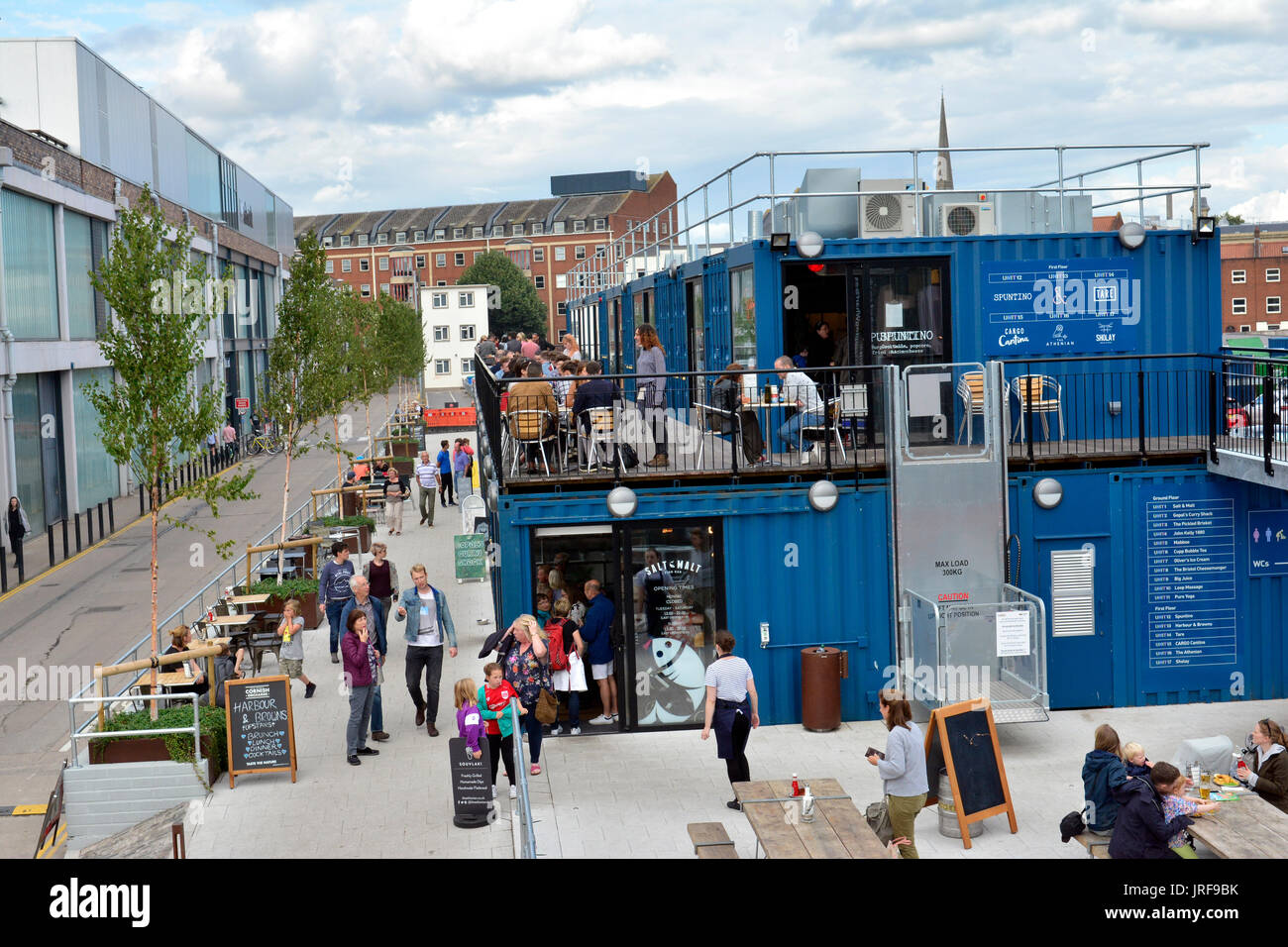 Bristol, UK. 5th August, 2017. UK Weather. On a warm summers evening in Bristol theres no finer way to relax and enjoy an evening drink and great outdoors food, in the newly installed Cargo Containers next to the M Shed on the docksideBristol of the floating Harbour. People also seen relaxing in armchairs sitting on a wall and taking a riverside trip. Mandatory Byline Robert Timoney/Alamy/Live/News - Stock Image