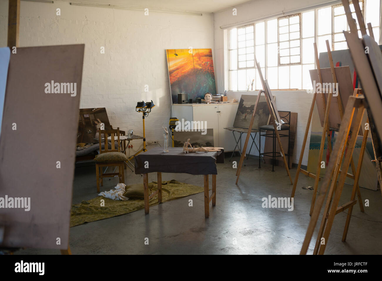 Easels with artists canvas in art class - Stock Image