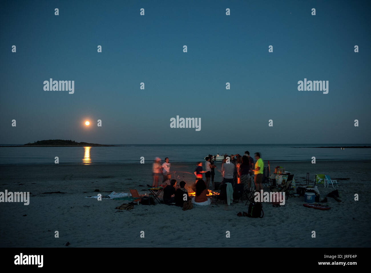 Families gather for a full moon cookout on Goose Rocks Beach, Kennebunkport, Maine, United States - Stock Image