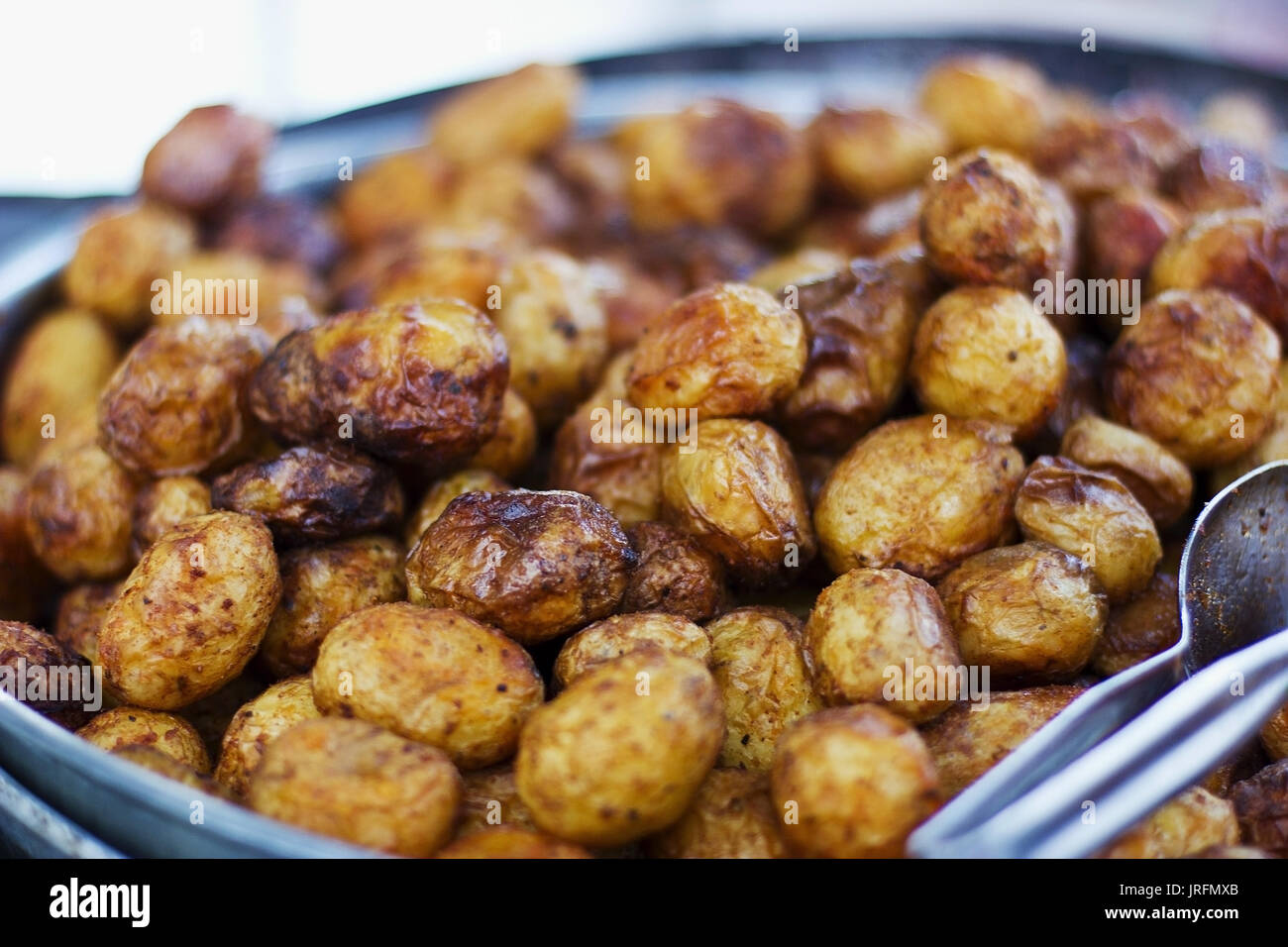 Baked yellow brown young patatoes - Stock Image