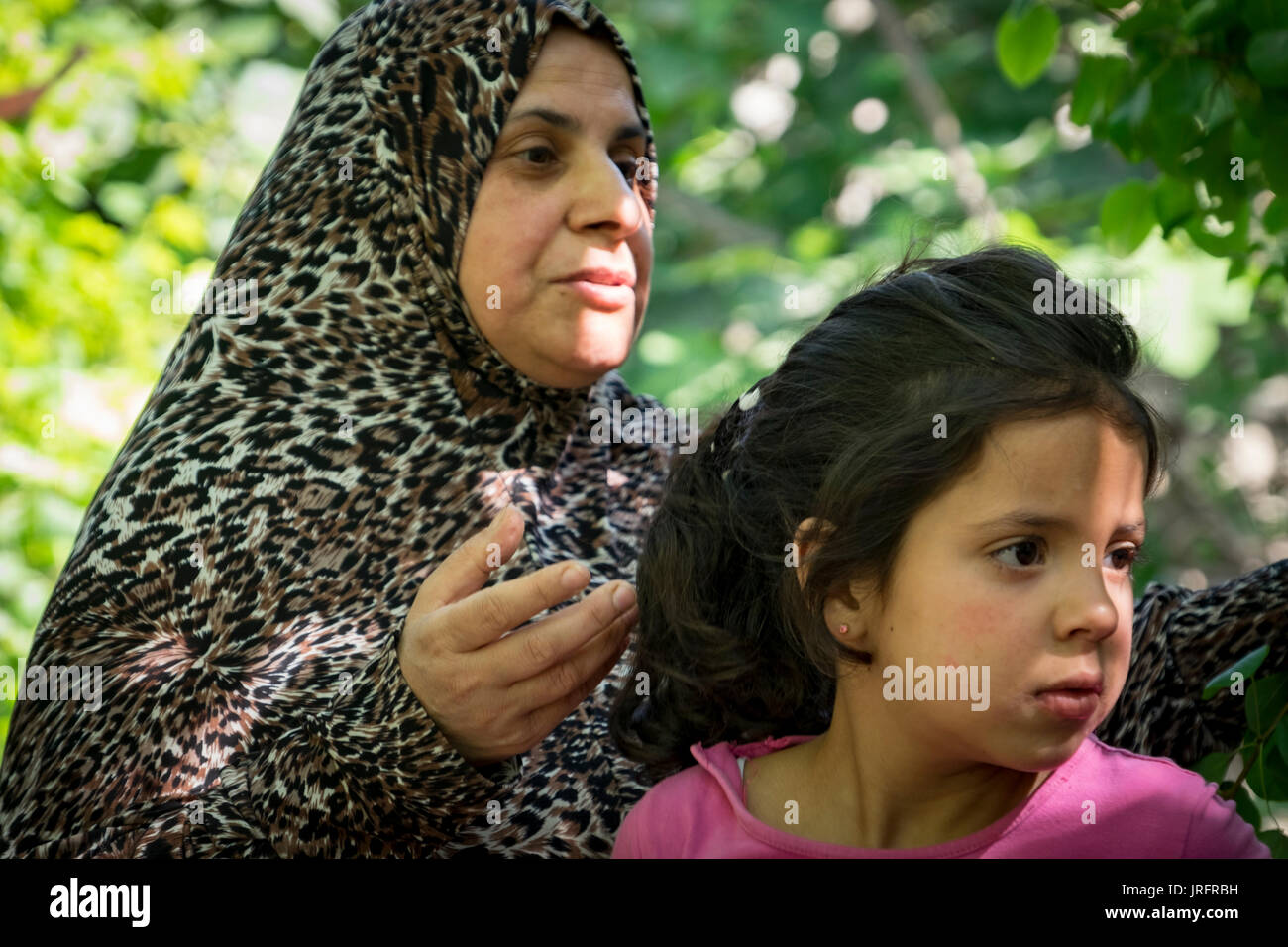 Palestinian mother & daughter describe their interactions with their Israeli settler neighbors in the center of Hebron in the Occupied Territories - Stock Image