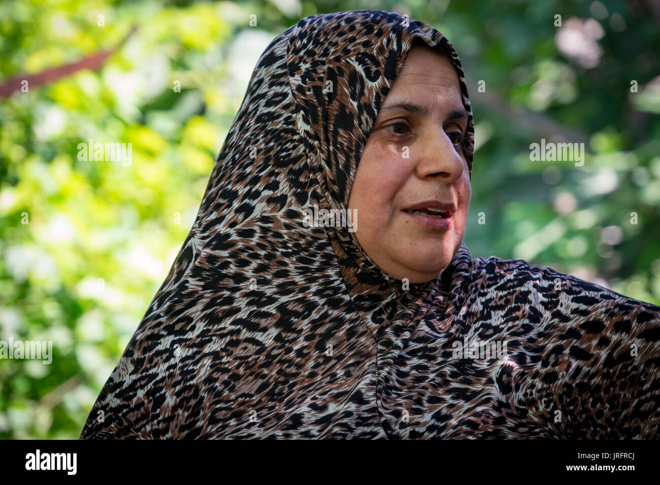 A Palestinian mother describes the harassment she has experienced at the hands of the Israeli settlers living next door in Hebron, Occupied Territory - Stock Image