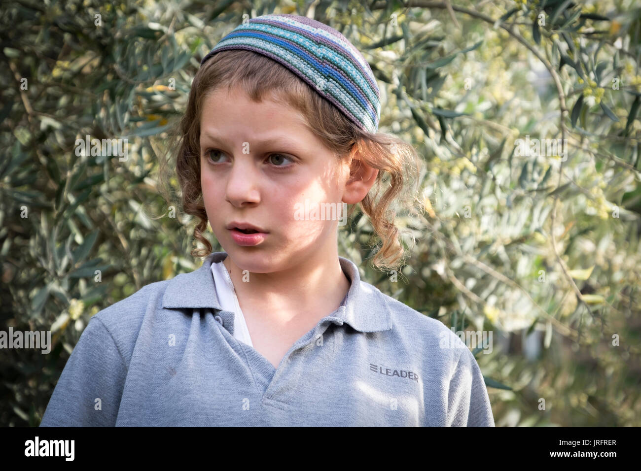 Young Israeli settler child in Hebron, Palestine observes an altercation between settlers and Palestinians - Stock Image
