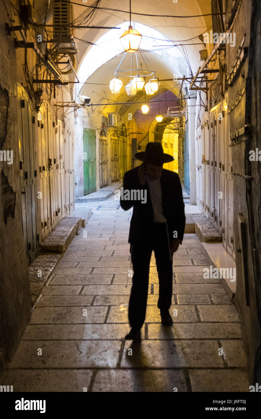 A Yeshivish orthodox Jew walks down the deserted streets of the Old City of Jerusalem due to a mandated closure Stock Photo