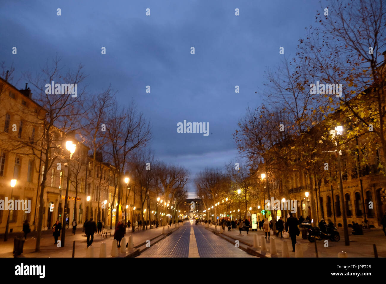 A winter's night on the Cours Mirabeau after a cold rain in the city of Aix-en-Provence, a gem of the Provence - Stock Image