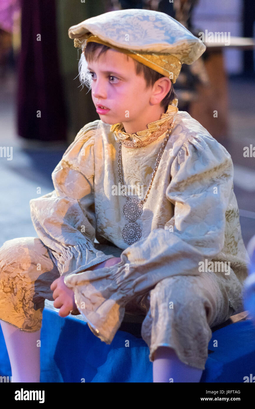 0c3bdd2394746 Young boy dressed in a Renaissance costume with cap at a Renaissance fair in  southern France