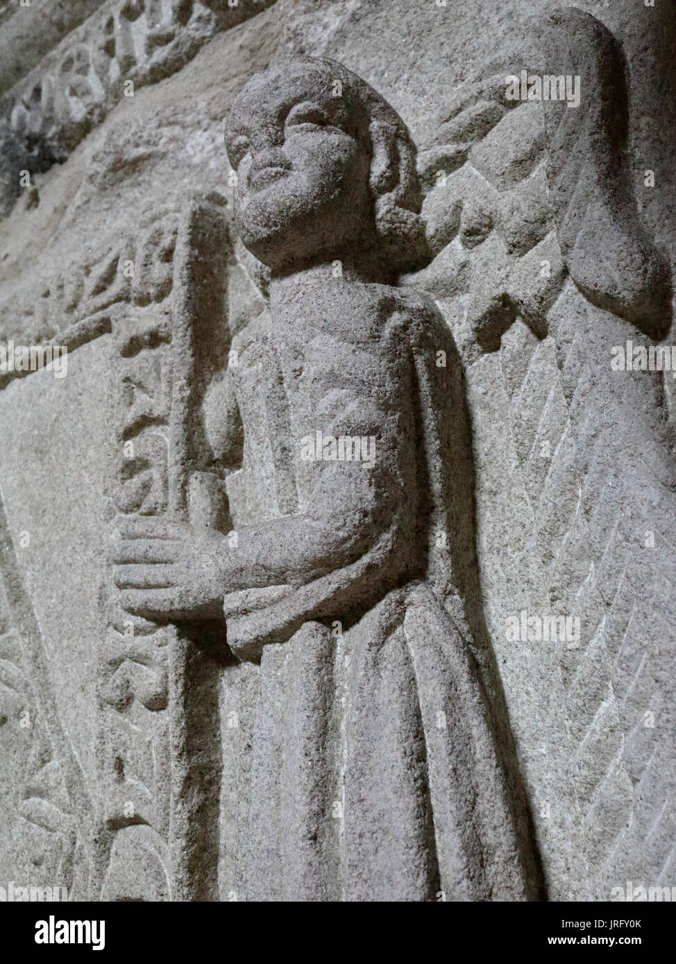 A close view of a stone low relief of an angel holding a shield - Stock Image