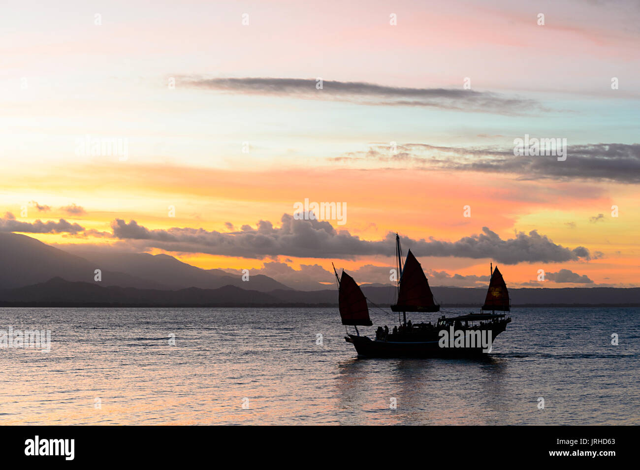 Chinese Junk taking tourists on a sunset cruise, Port Douglas, Far North Queensland, FNQ, QLD, Australia - Stock Image