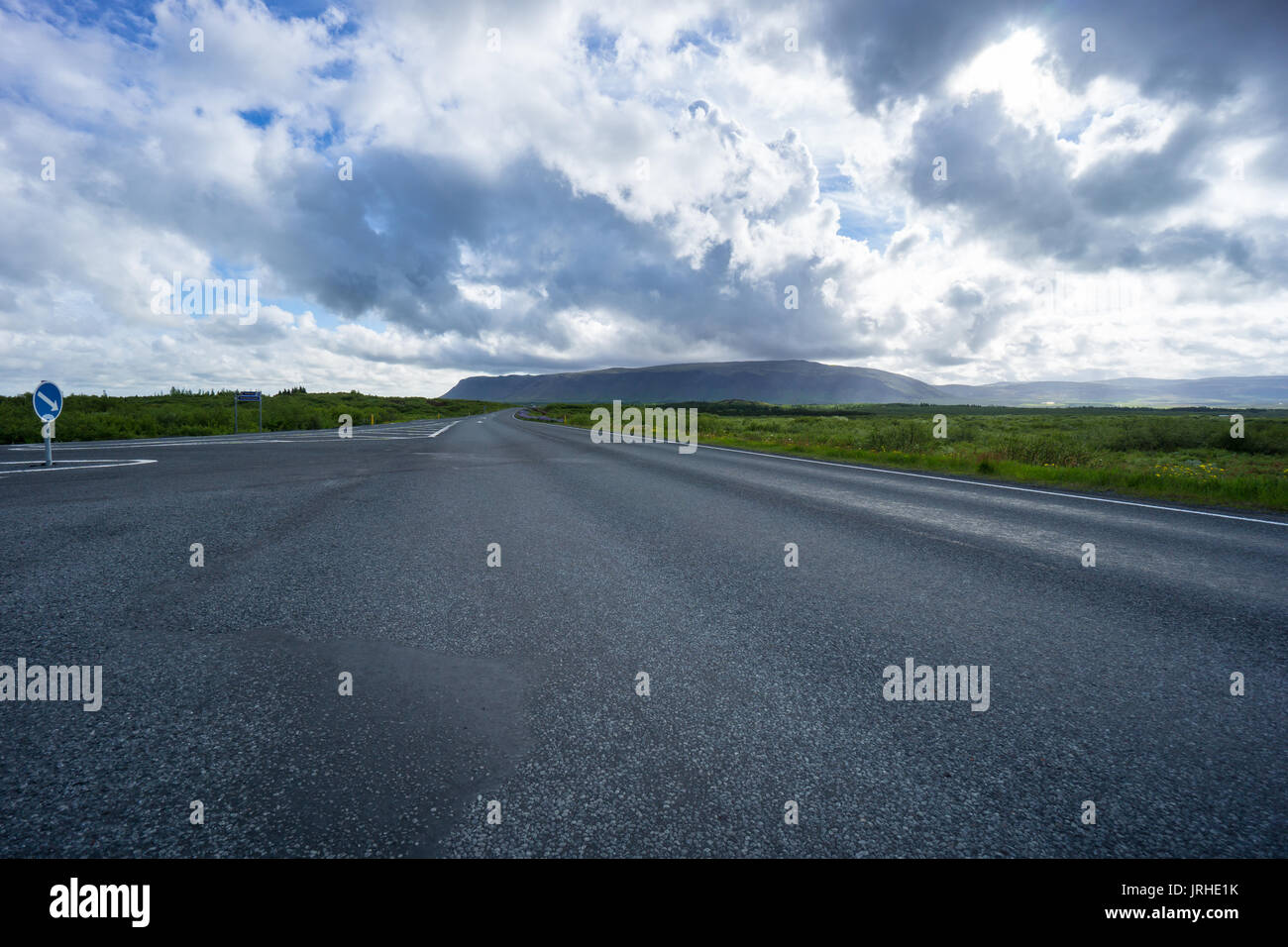 Iceland - Highway intersection between green meadows - Stock Image