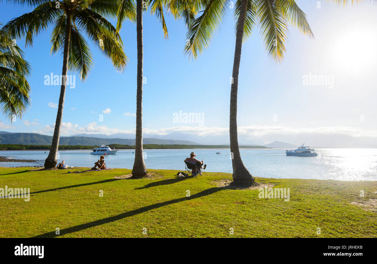 People relaxing and watching sunset from Rex Smeal Park, Port Douglas, Far North Queensland, FNQ, QLD, Australia - Stock Image
