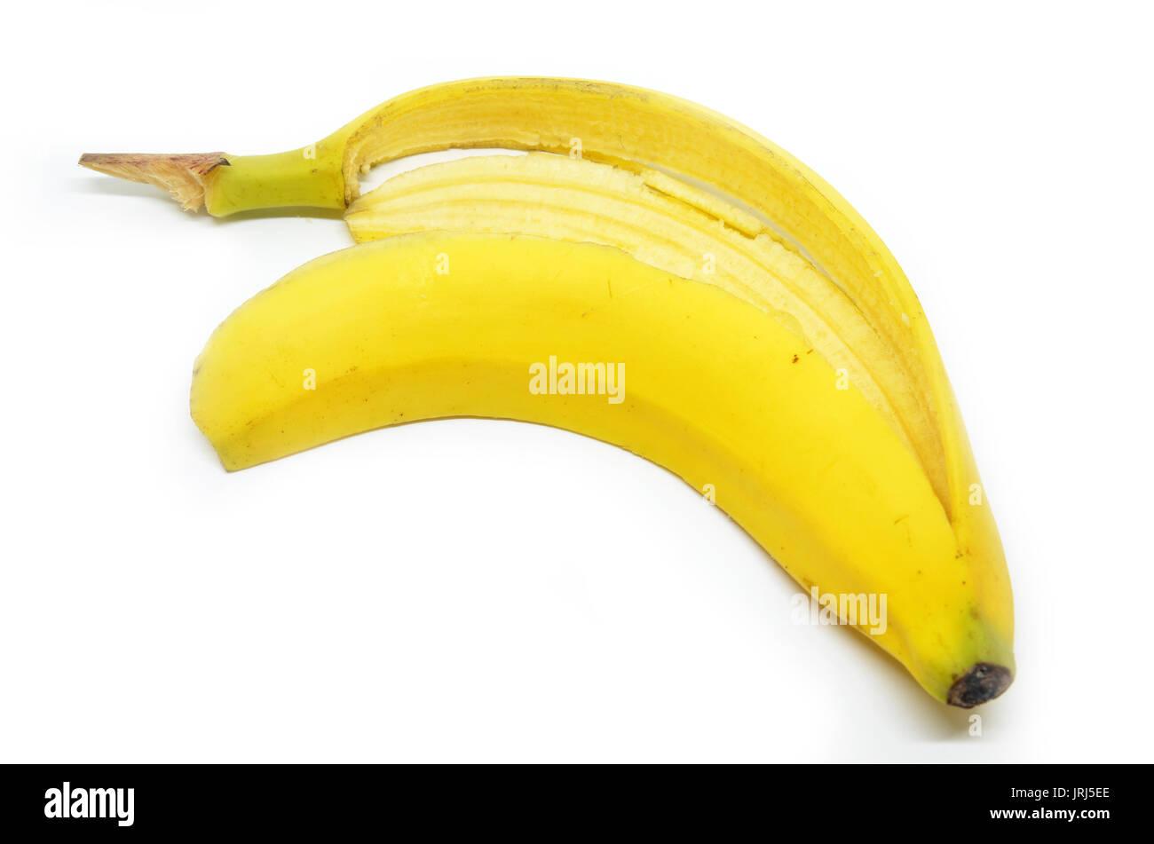Slippery banana skin on a white background - Stock Image