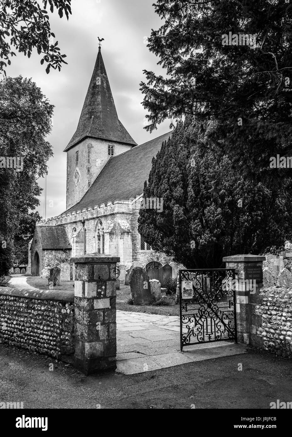 Black and white image of Holy Trinity Church, Bosham, West Sussex, England - Stock Image