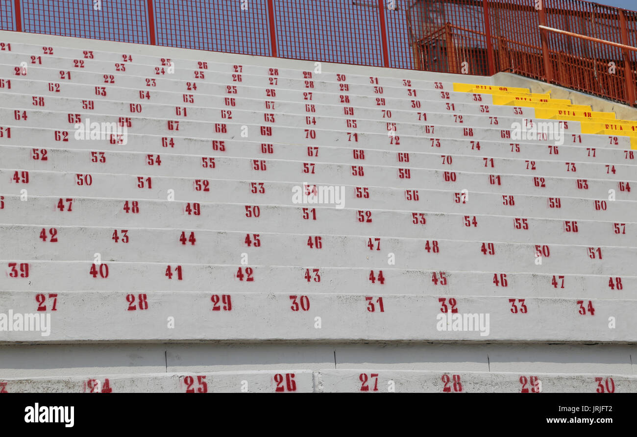 many numbers on the stadium bleachers to indicate a seat at sporting events - Stock Image