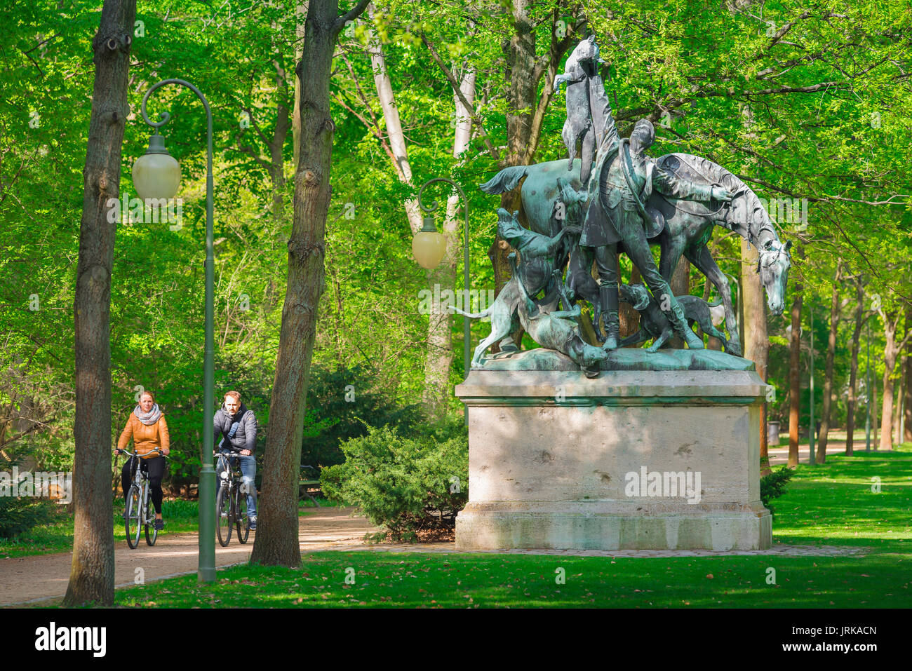 Berlin cycling park, cyclists in Berlin use the extensive cycle paths in the Tiergarten park, Germany. - Stock Image