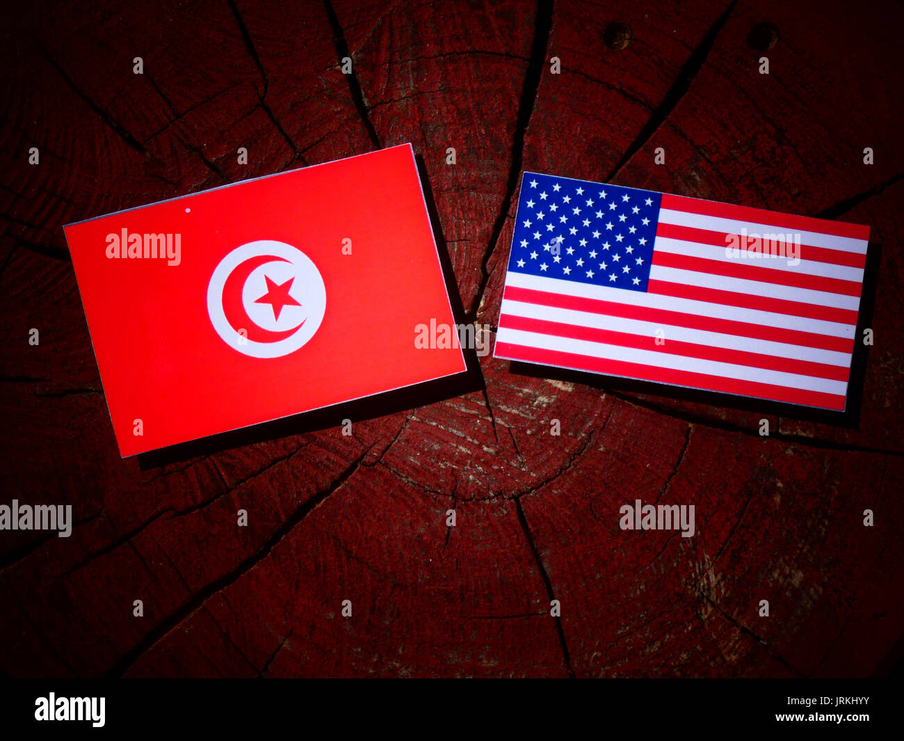 Tunisian Flag With Usa Flag On A Tree Stump Isolated Stock Photo Alamy