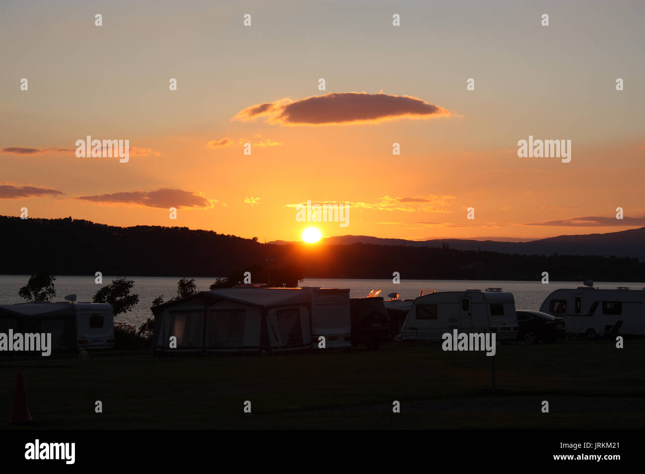 Sunset view of Ardmucknish Bay from North Ledaig Caravan and Motorhome Club camping site. Near Oban. Argyll. Scotland. - Stock Image