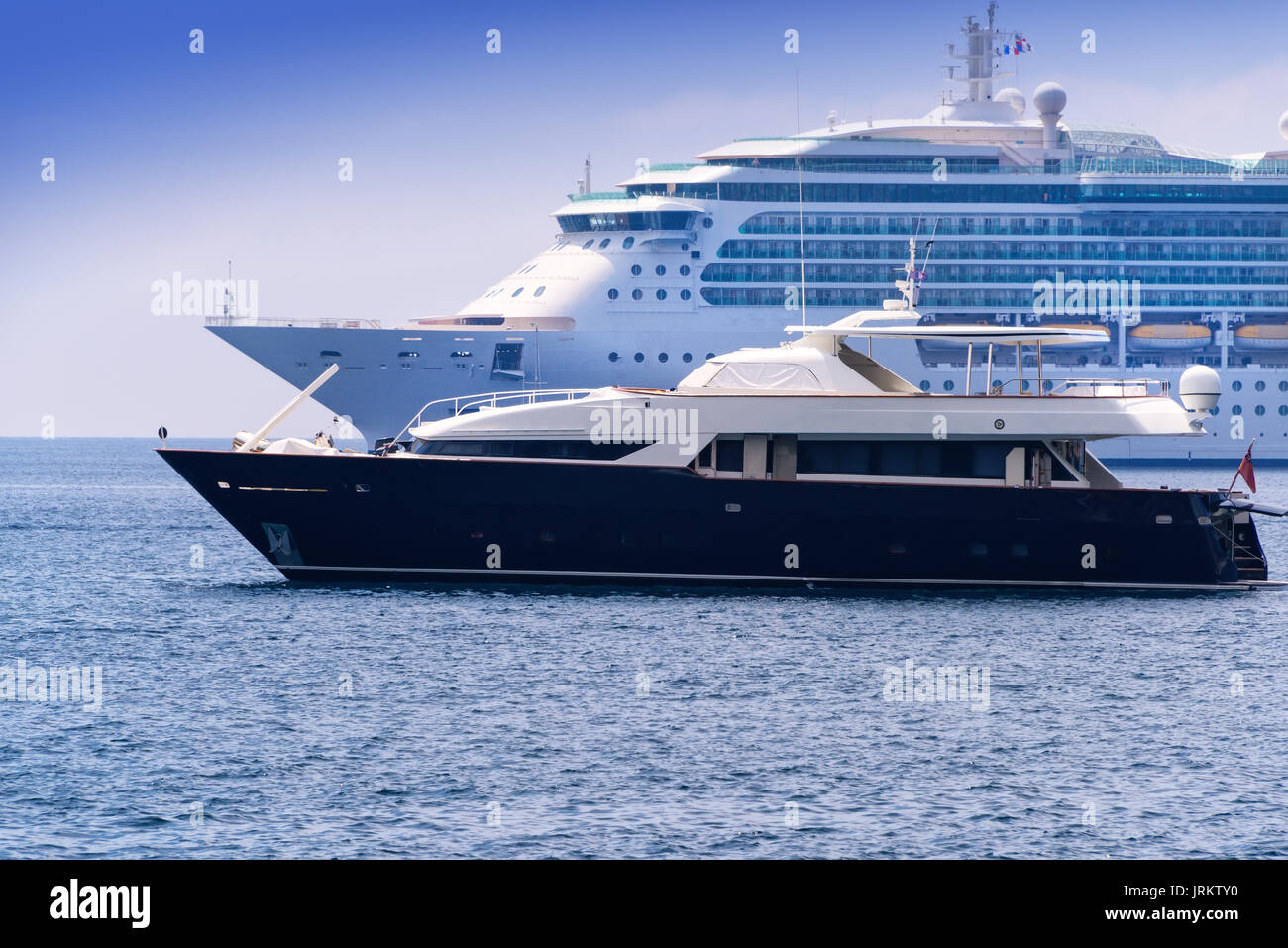 Cruise ship and yacht anchored in a harbor in Nice, France. - Stock Image