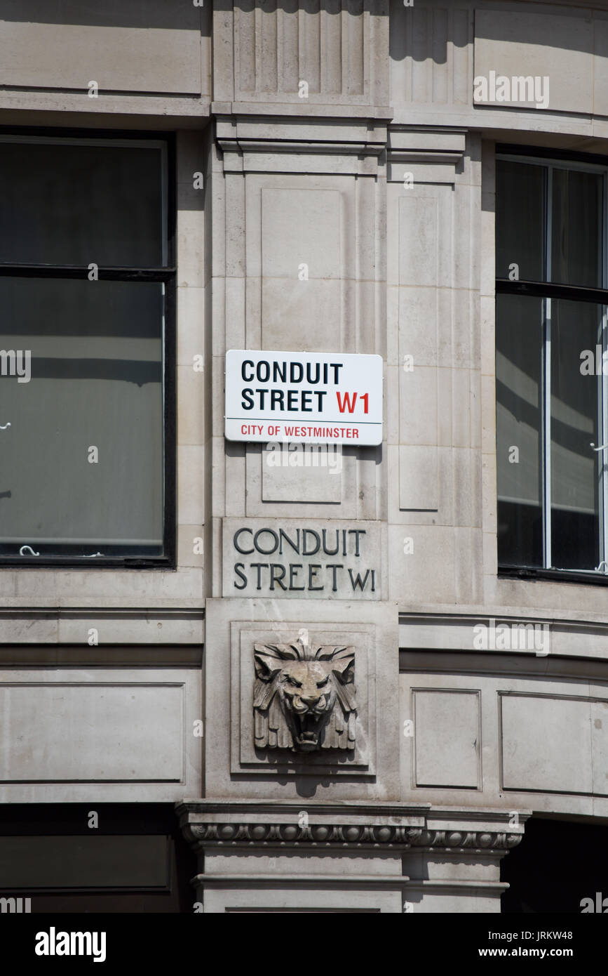 Conduit Street road sign modern and old carved stone lettering. City of Westminster, London. Space for copy - Stock Image