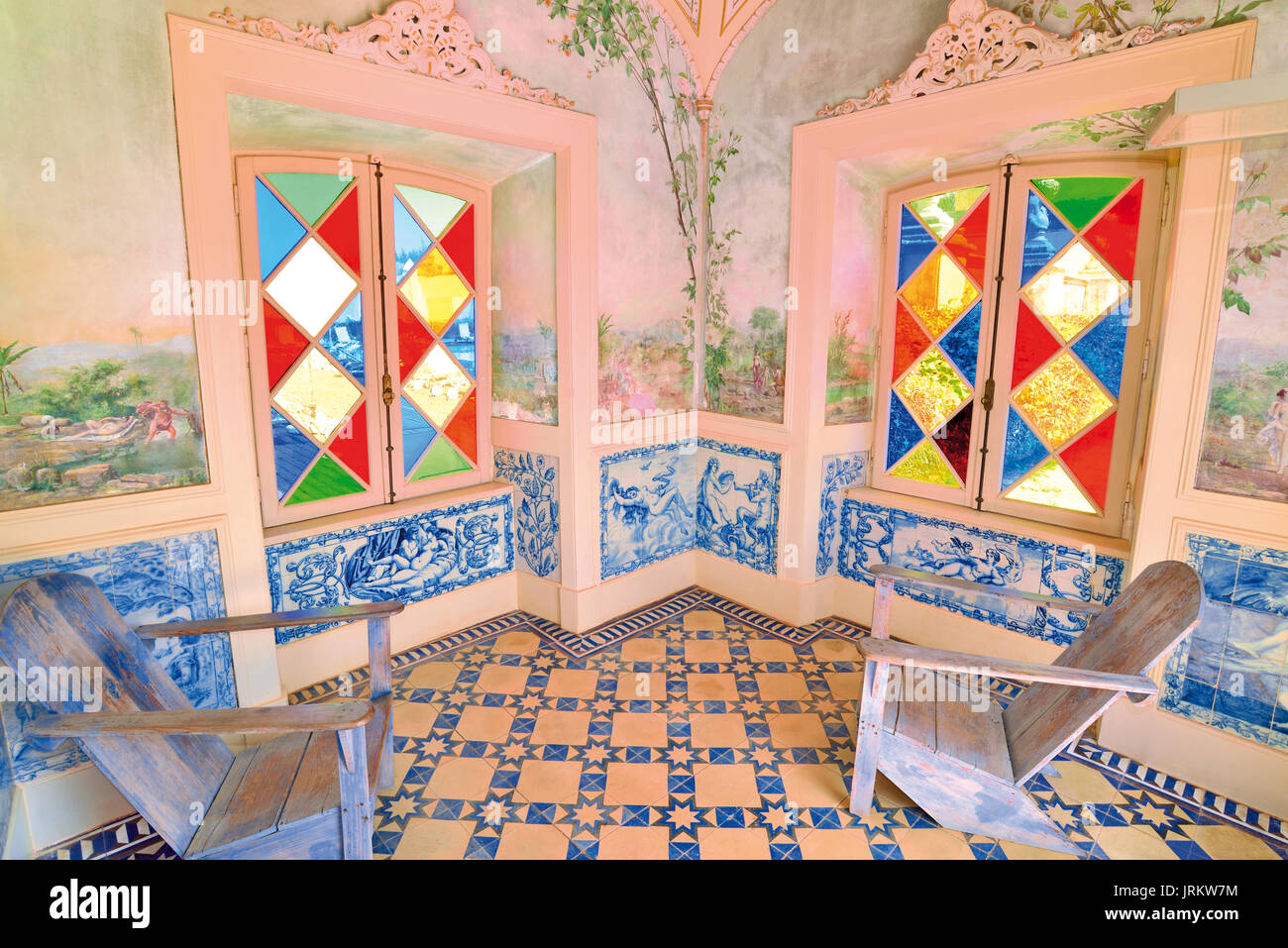Algarve: Inside look to a garden pavilion with colorful glass windows and tile decoration of Estoi Palace Hotel - Stock Image