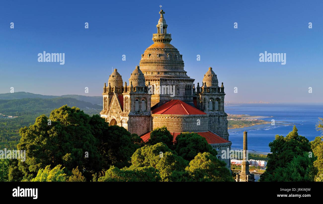 Unique view with the basilica de Santa Luzia, green hills and blue ocean - Stock Image