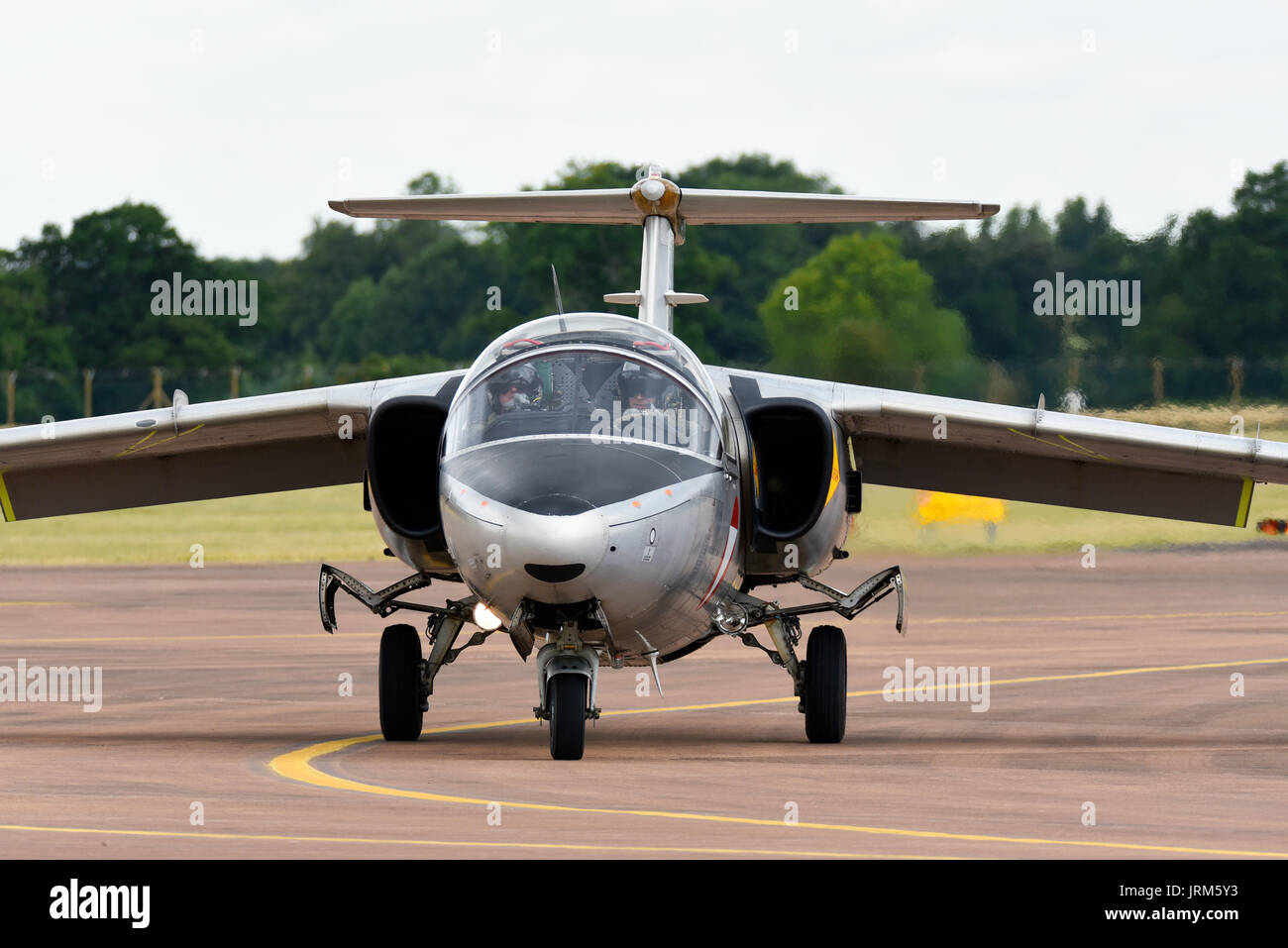 Austrian Air Force Saab 105 plane taxiing in. Pilots. Space for copy - Stock Image
